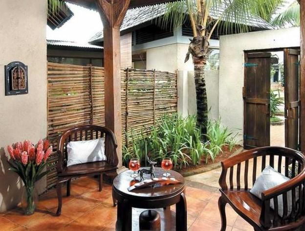Desain Ruang Tamu Rumah Kayu Sederhana